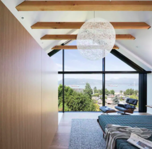 View from the master bedroom of the ocean and north shore from a pentagonal window