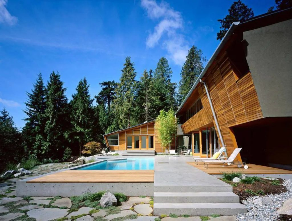 Luxurious Airbnb home in West Vancouver - Exterior view of pool, trees, and sky