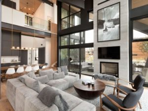 Interior photo of the Whistler Escape home, with fireplace, floor to ceiling windows.