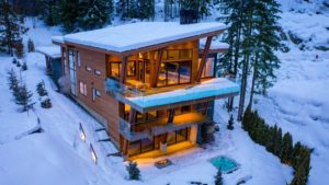 Exterior aerial photo of the Heritage Peak Home in the winter time